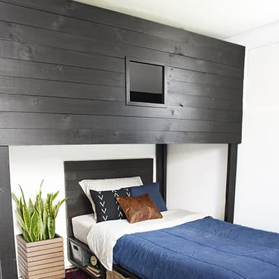 A bedroom that features a modern loft bed.