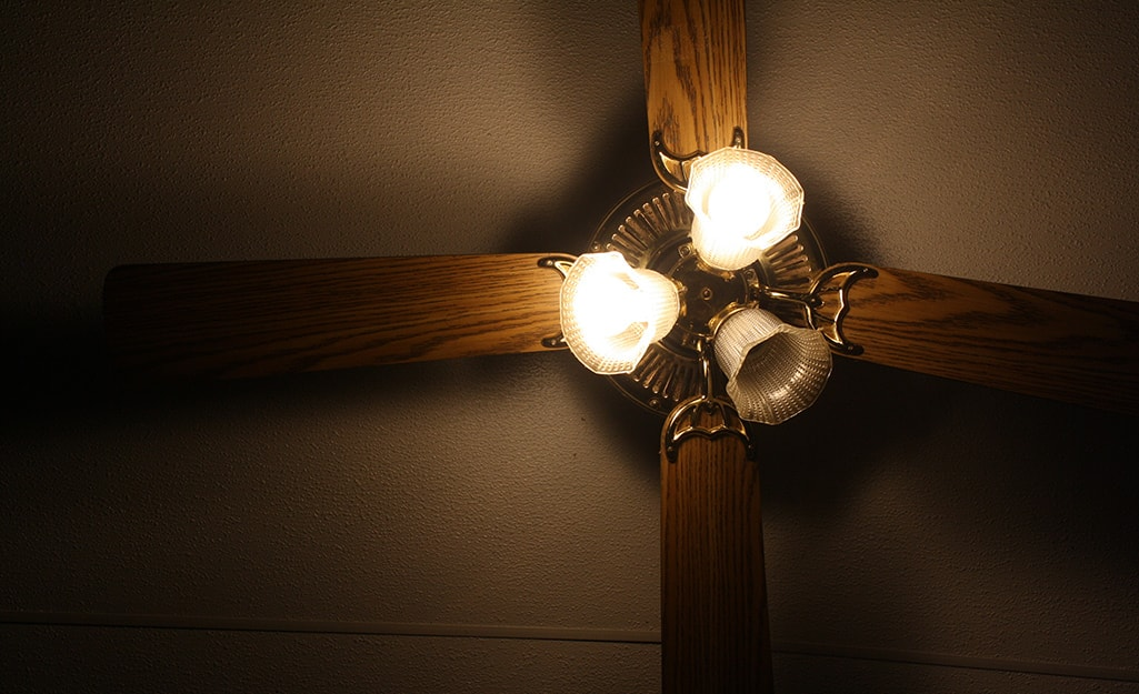 A ceiling fan with one light not working.