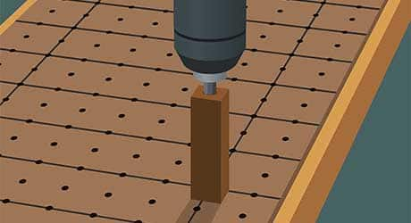 Drilling holes for a built-in shelving unit