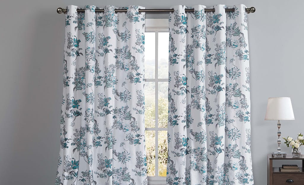 White and blue light-filtering curtains over a window.
