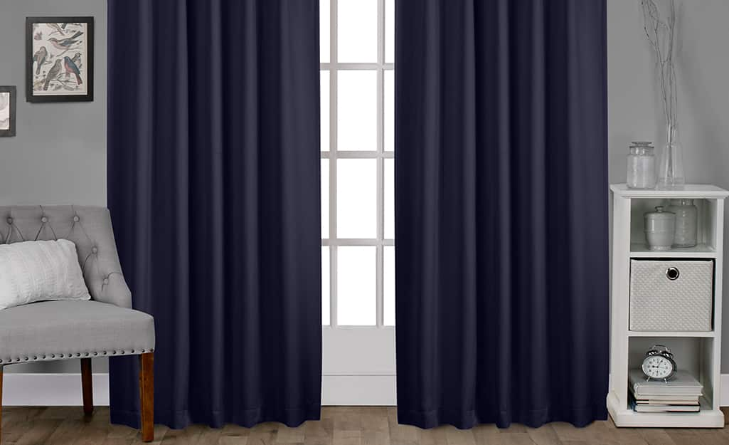 Blackout curtains over a bedroom window.