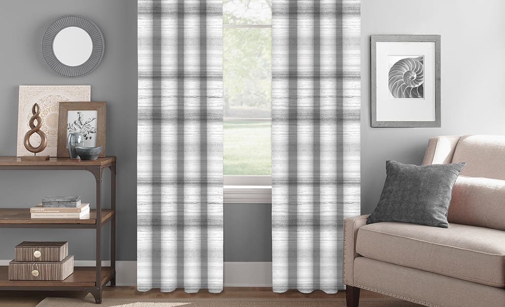 Striped gray and white curtains in a living room.