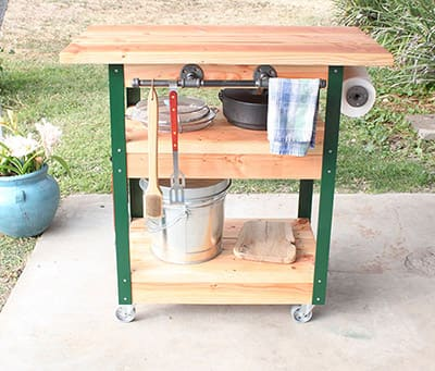 A DIY grilling cart with wheels.