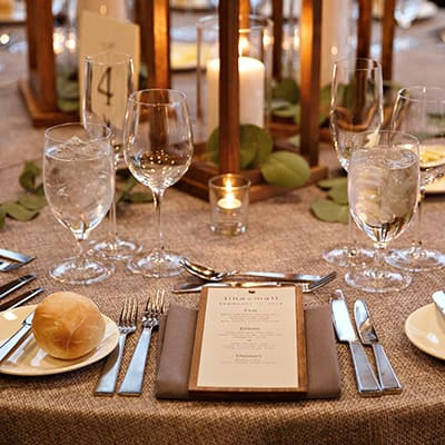 A place setting with a DIY wood backed menu.