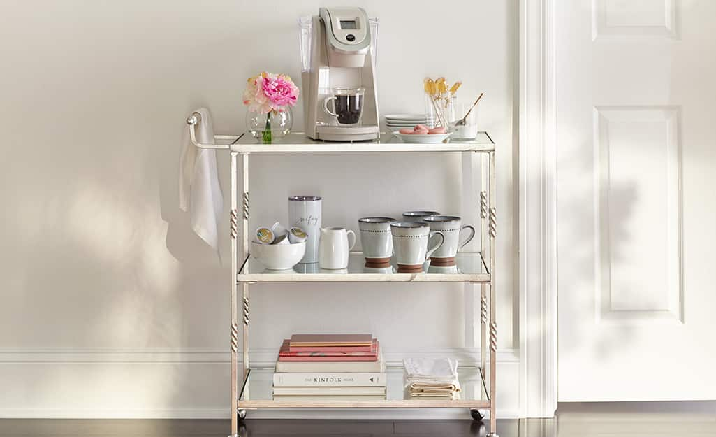 A bar cart turned into a coffee bar in the kitchen.