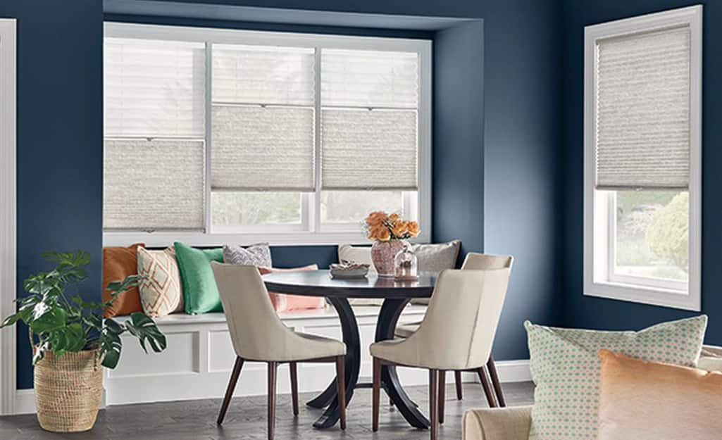 A breakfast nook with Trilight cellular shades on the windows.