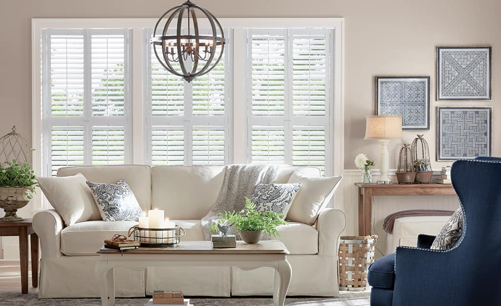 A living room with interior plantation shutters on the windows.