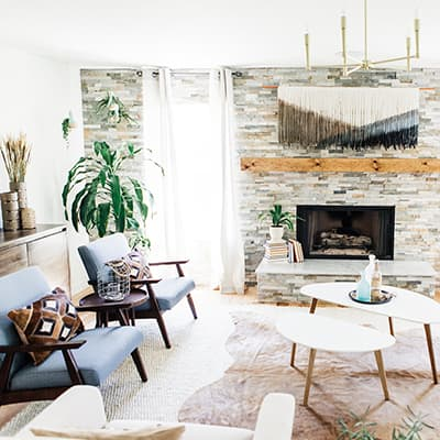 A family room with a stone fireplace.