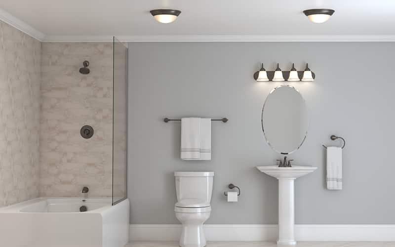 a bathroom featuring flush-mount vanity lighting