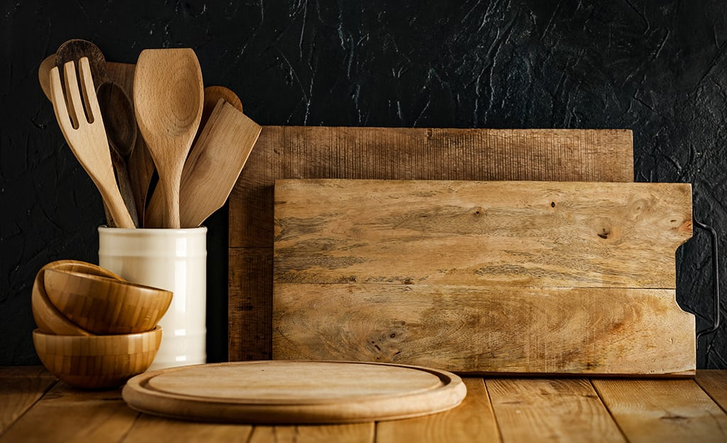 A selection of wood kitchen utensils lying on a counter.