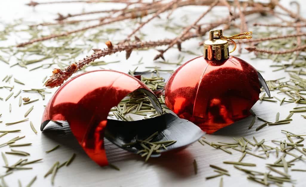 Broken red ornaments and fir needles