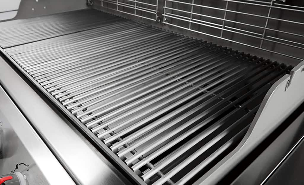 An open grill with clean grill grates.