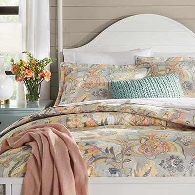 guest bed with pink and blue bedding
