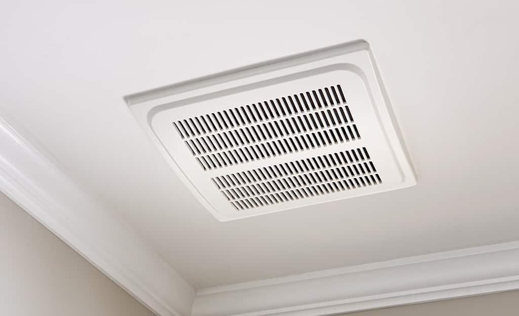 A Hampton Bay bath fan installed in a ceiling.
