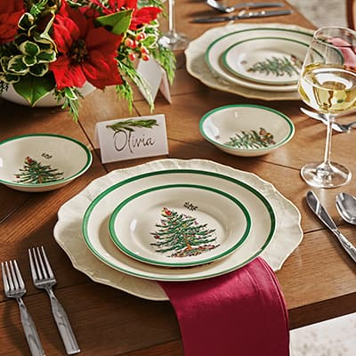 Holiday table with Christmas China and poinsettia centerpiece