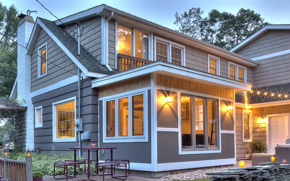 A house with lit flood lights.