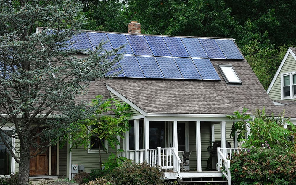 A house with solar panels installed on the roof.