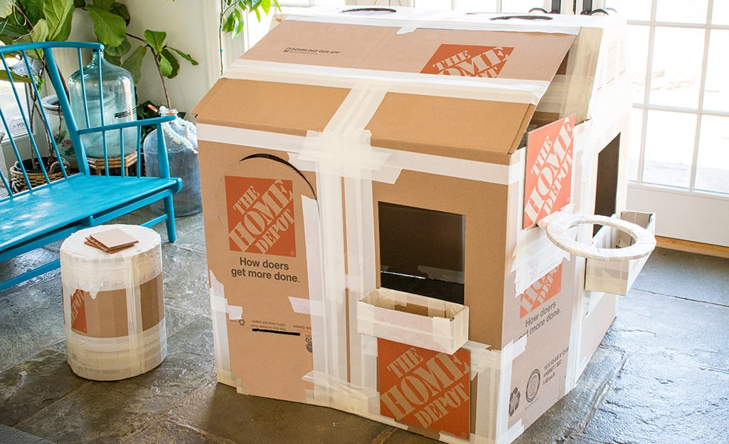 An assembled deluxe cardboard playhouse before decoration.