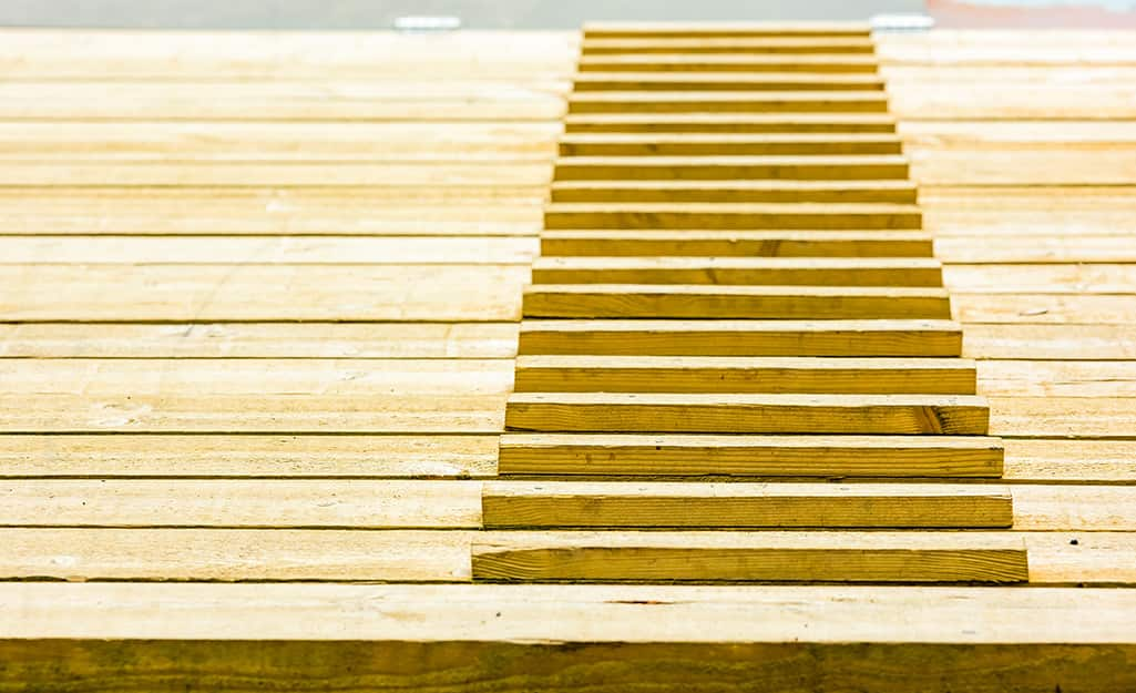 Cleats or steps on a chicken ramp.