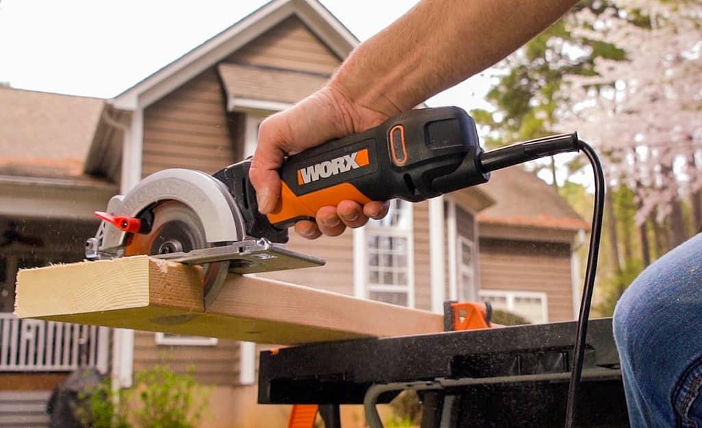 Someone cutting a wood board.