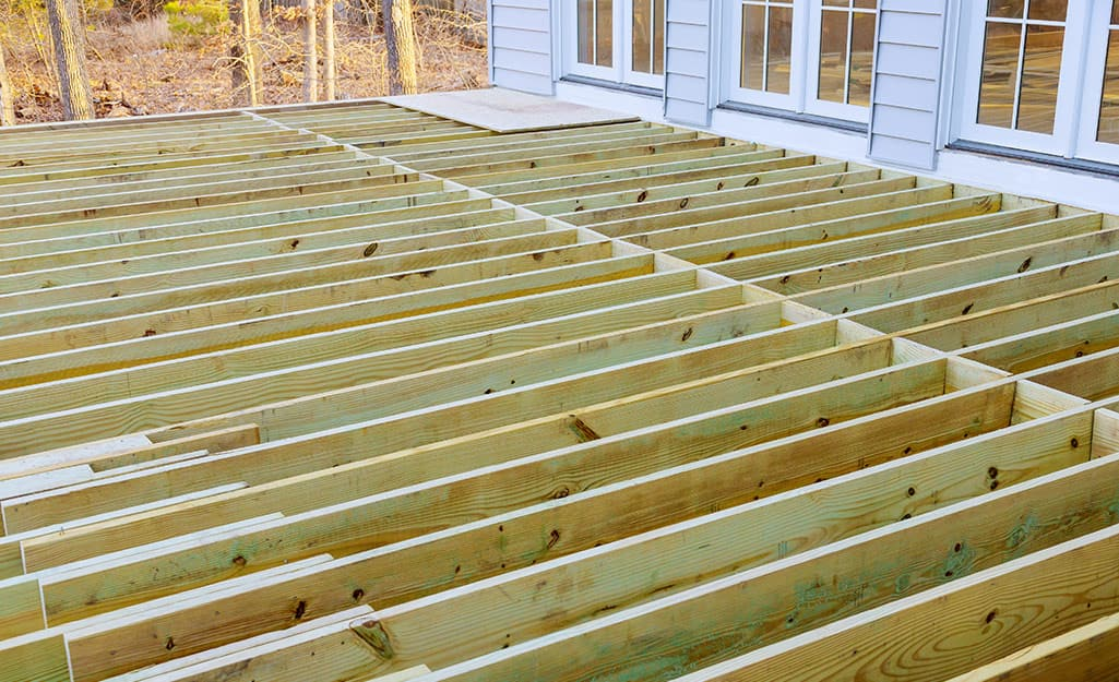 Lumber laid out to form a deck.