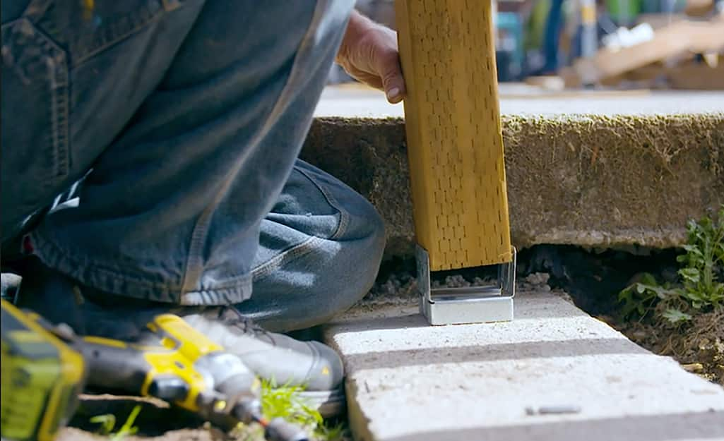 A beam being attached to form a deck.