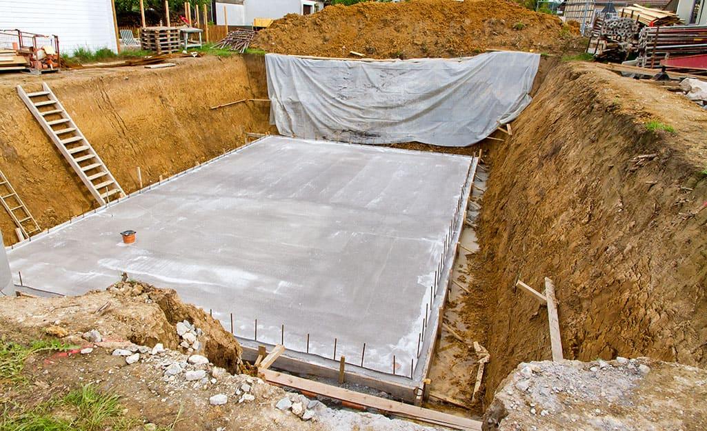 The concrete slab for a basement foundation.
