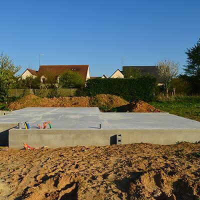 A concrete foundation for a home.