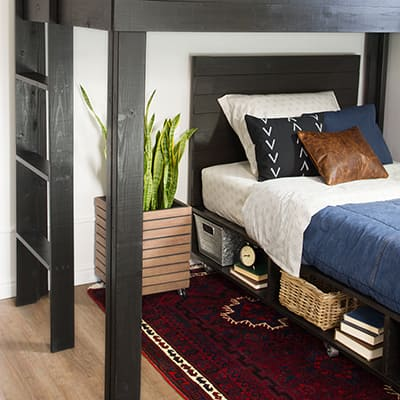 A bedroom featuring a modern bed with storage.