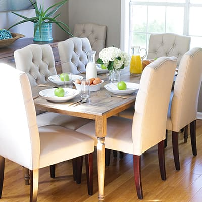 A dining room with a rustic farmhouse dining table.
