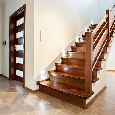 Stairs in a foyer by the front door.