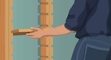 Illustration of a man slipping shelves into wooden frames.