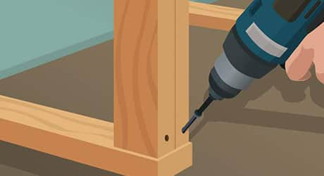 Illustration of someone drilling end shelves into sole plates.