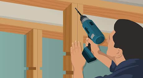 Illustration of a man drilling center shelf supports into place.