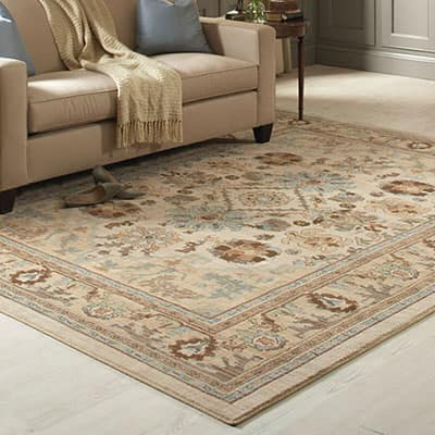 A large area rug in the middle of a living room