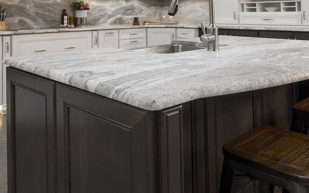 A kitchen featuring newly installed marble countertops.