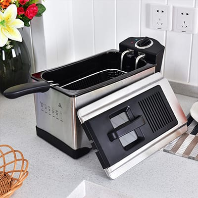A small deep fryer on a kitchen counter