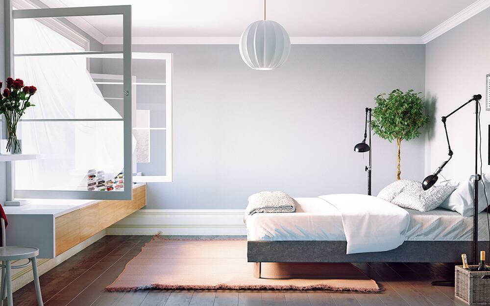 A bedroom with an open window, sunlight spilling onto the mattress.