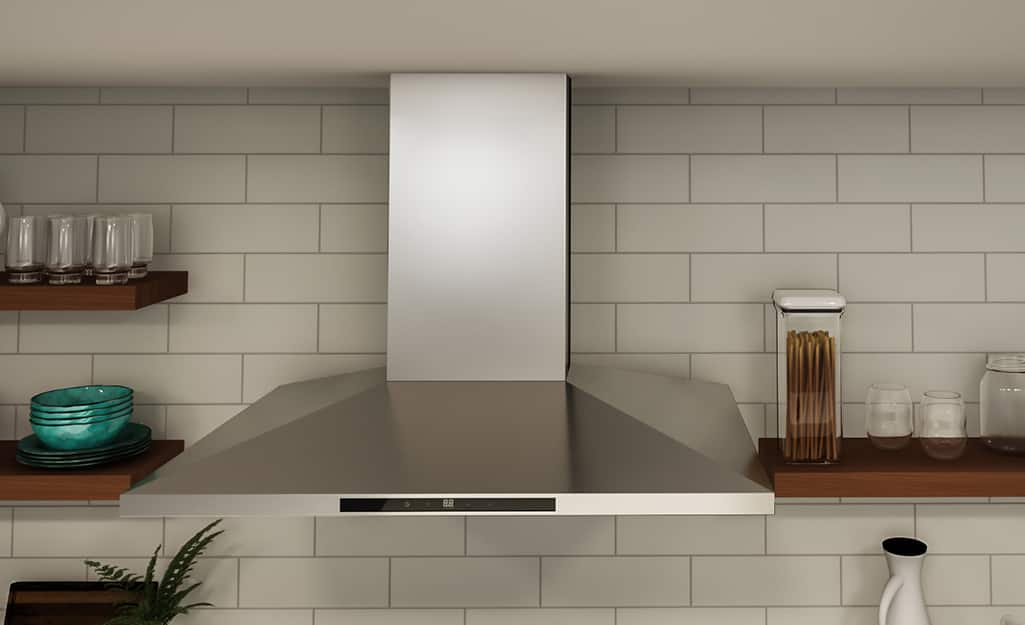 a range hood hanging from the ceiling of a kitchen