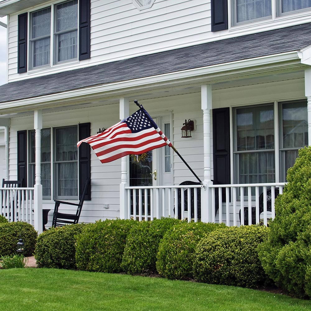 American flag being displayed on a porch.