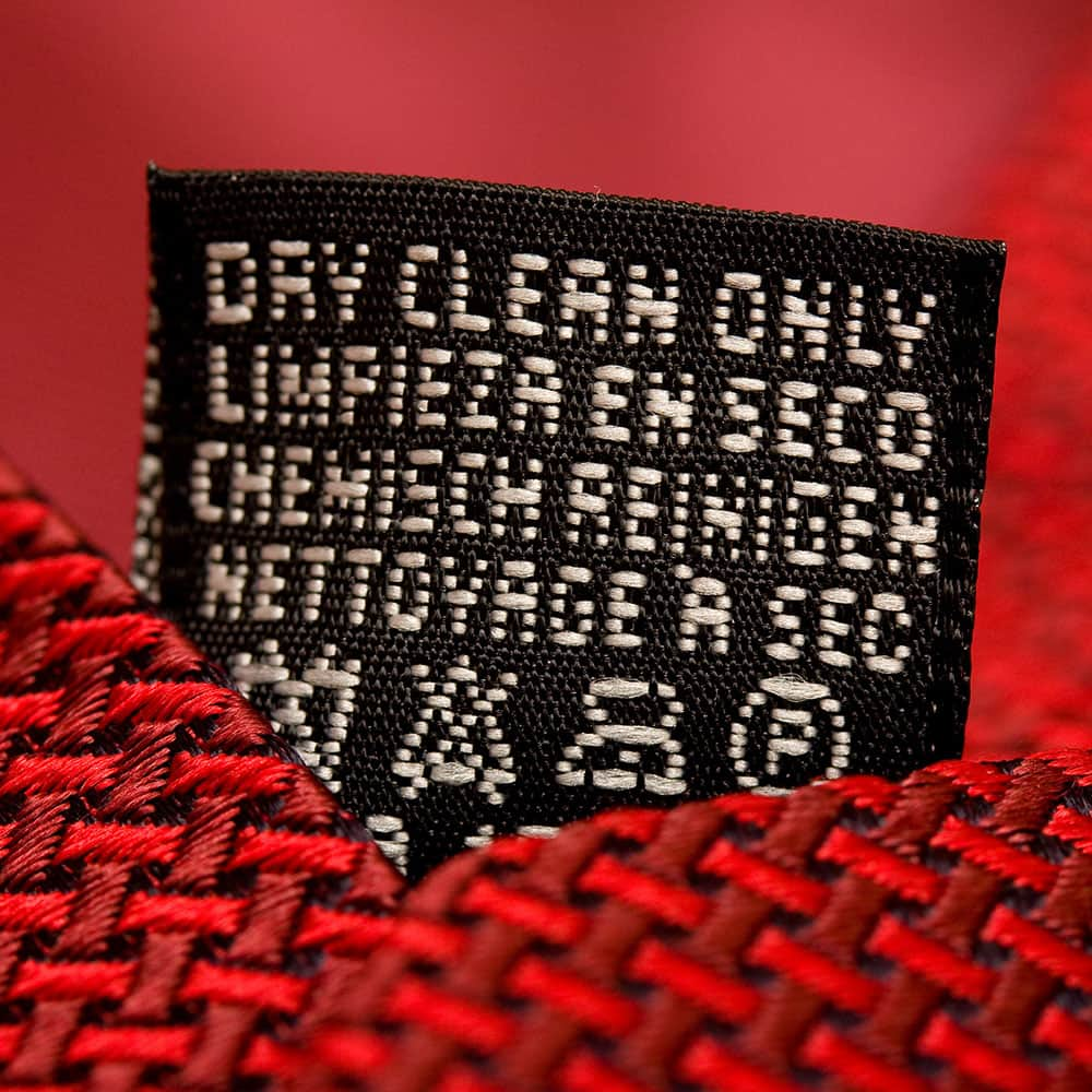 A clothing care label that suggests dry cleaning.