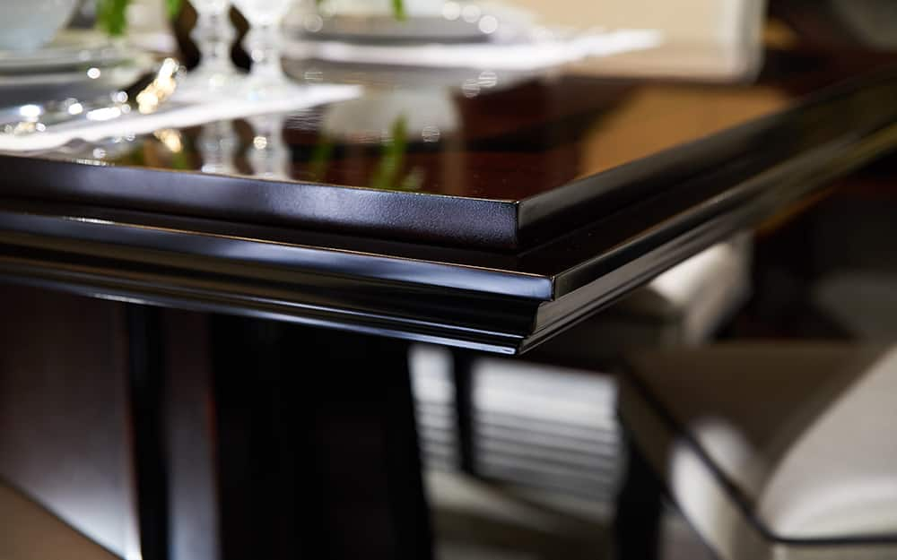 A table finished in black lacquer.