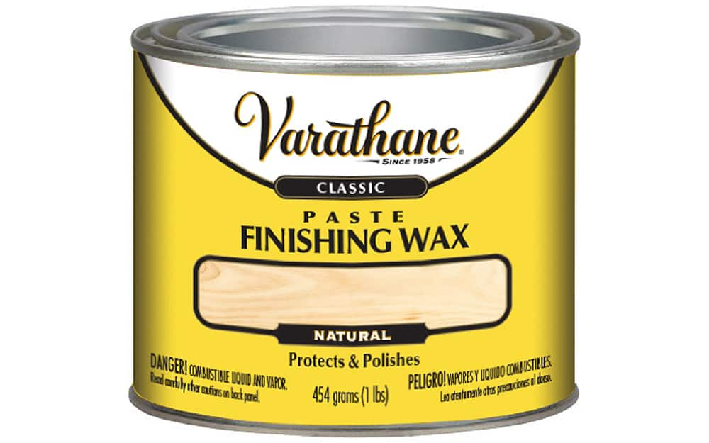 A can of finishing wax on a white background.