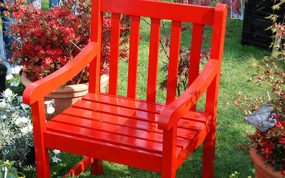 A chair finished in red lacquer.
