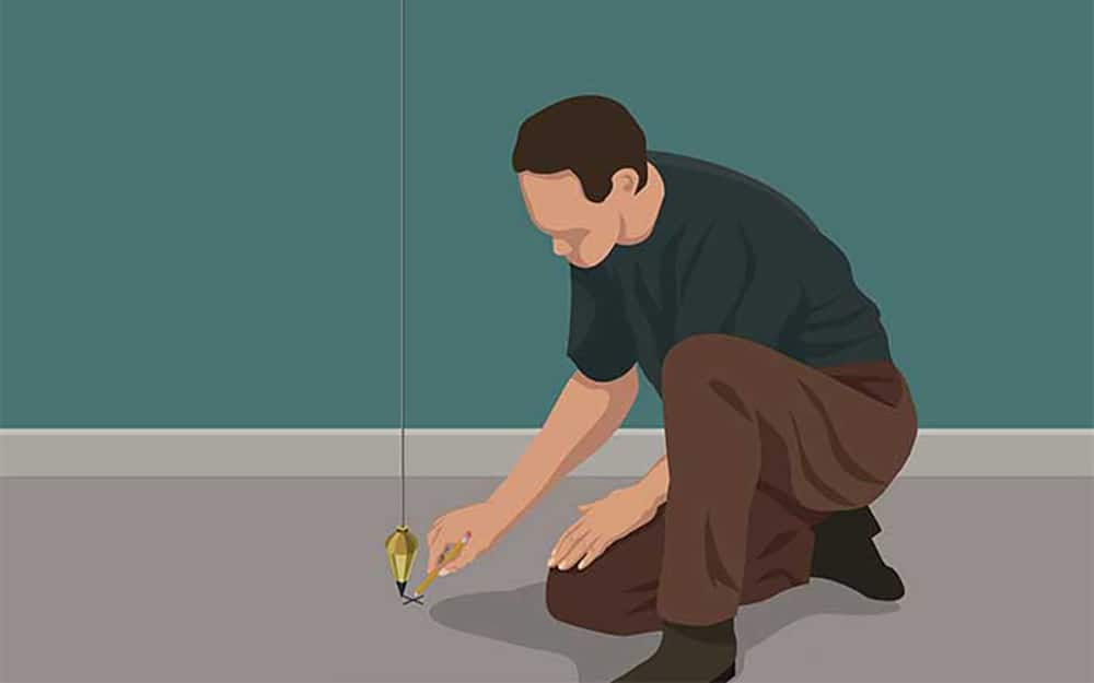 illustration of a man making a mark where the sole plate of a door frame will be installed
