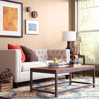 A living room with sofa and coffee table in an apartment.