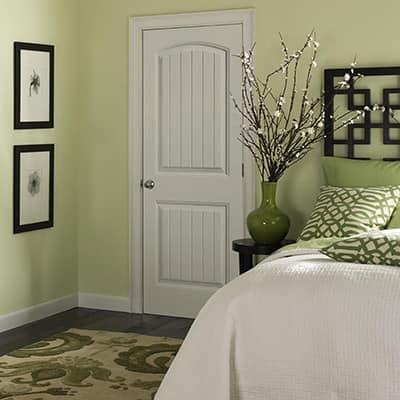 a white interior door in a bedroom