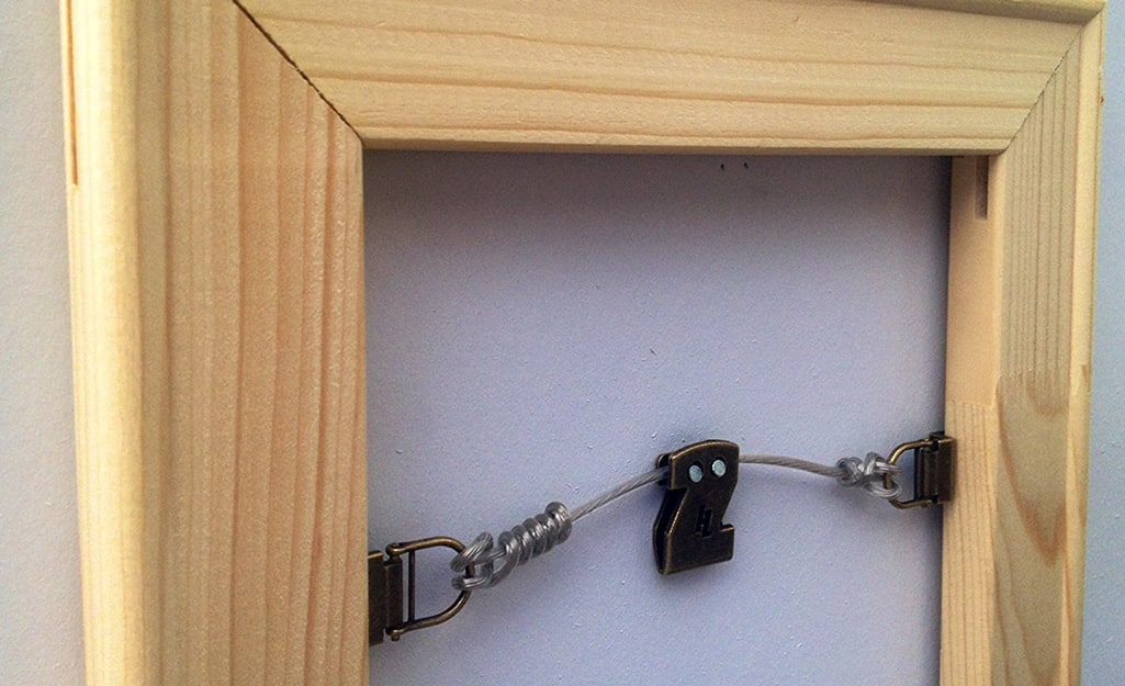 Double wire hanging on the back of a picture frame.