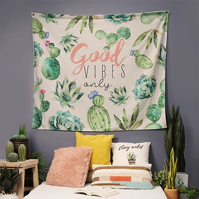 A tapestry hanging on the wall above a bed.