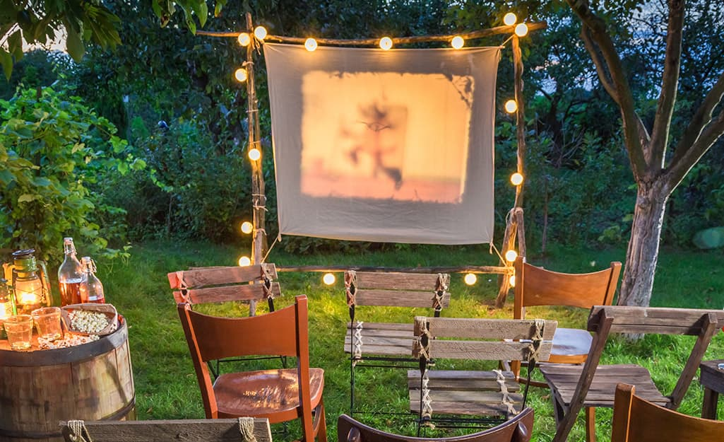 A DIY movie screen in a backyard.